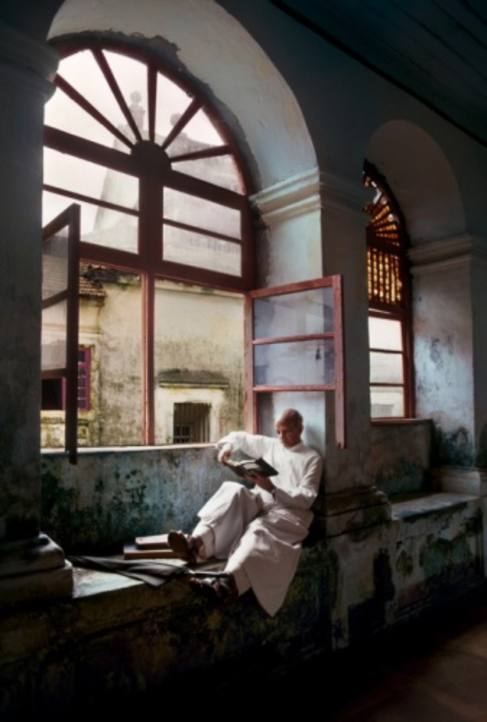 Steve McCurry: Man Reads by Window Goa, India, 1978
