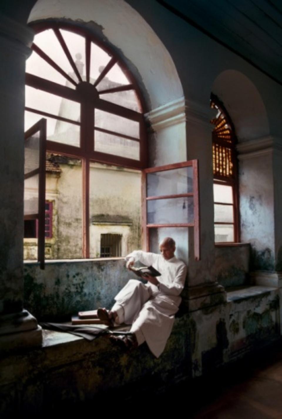 Steve McCurry: Man Reads by Window Goa, India, 1978