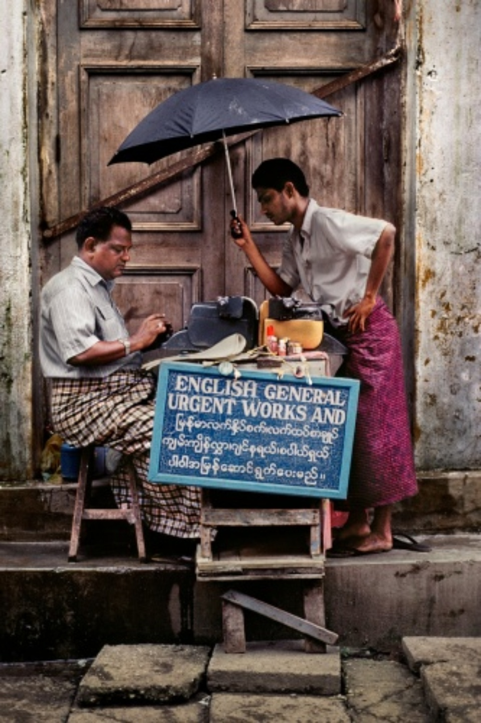 Steve McCurry: Typist, Rangoon Burma, 1994 C-print on Fuji Crystal paper Signed, titled, dated and numbered 60 x 50 cm Editioned