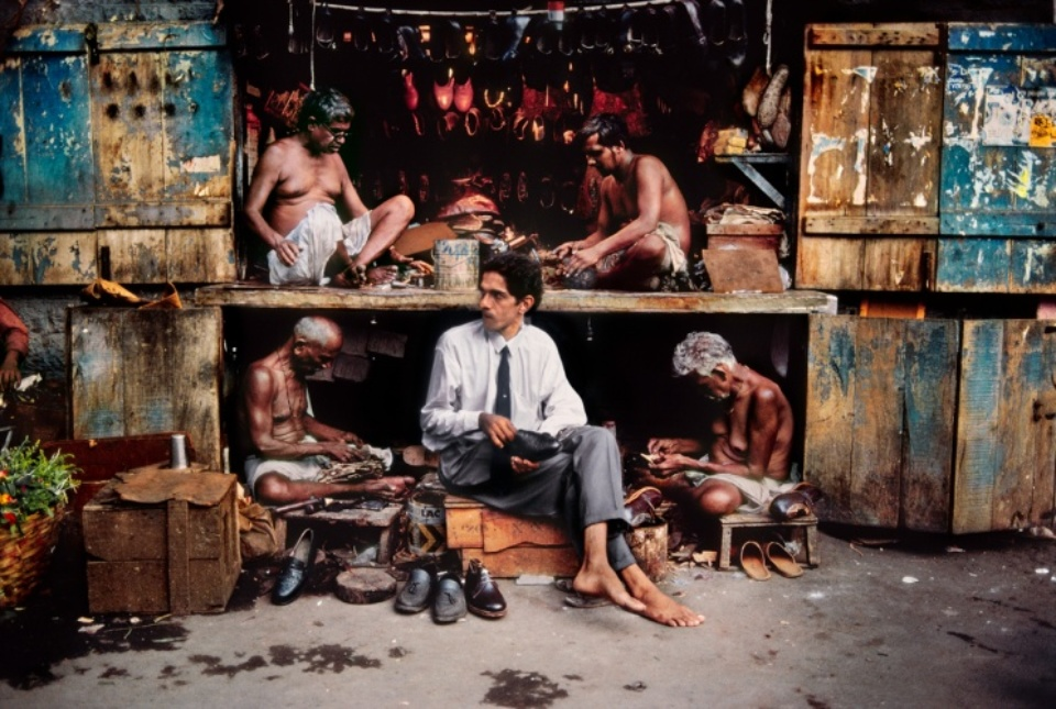 Steve McCurry: At the shoemaker Mumbai, India, 1996 C-print on Fuji Crystal paper Signed, titled, dated and numbered 50 x 60 cm Editioned