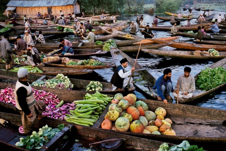 Steve McCurry: Shikaras on Dal Lake Srinagar, Kashmir, 1999 C-print on Fuji Crystal paper Signed, titled, dated and numbered 50 x 60 cm Editioned