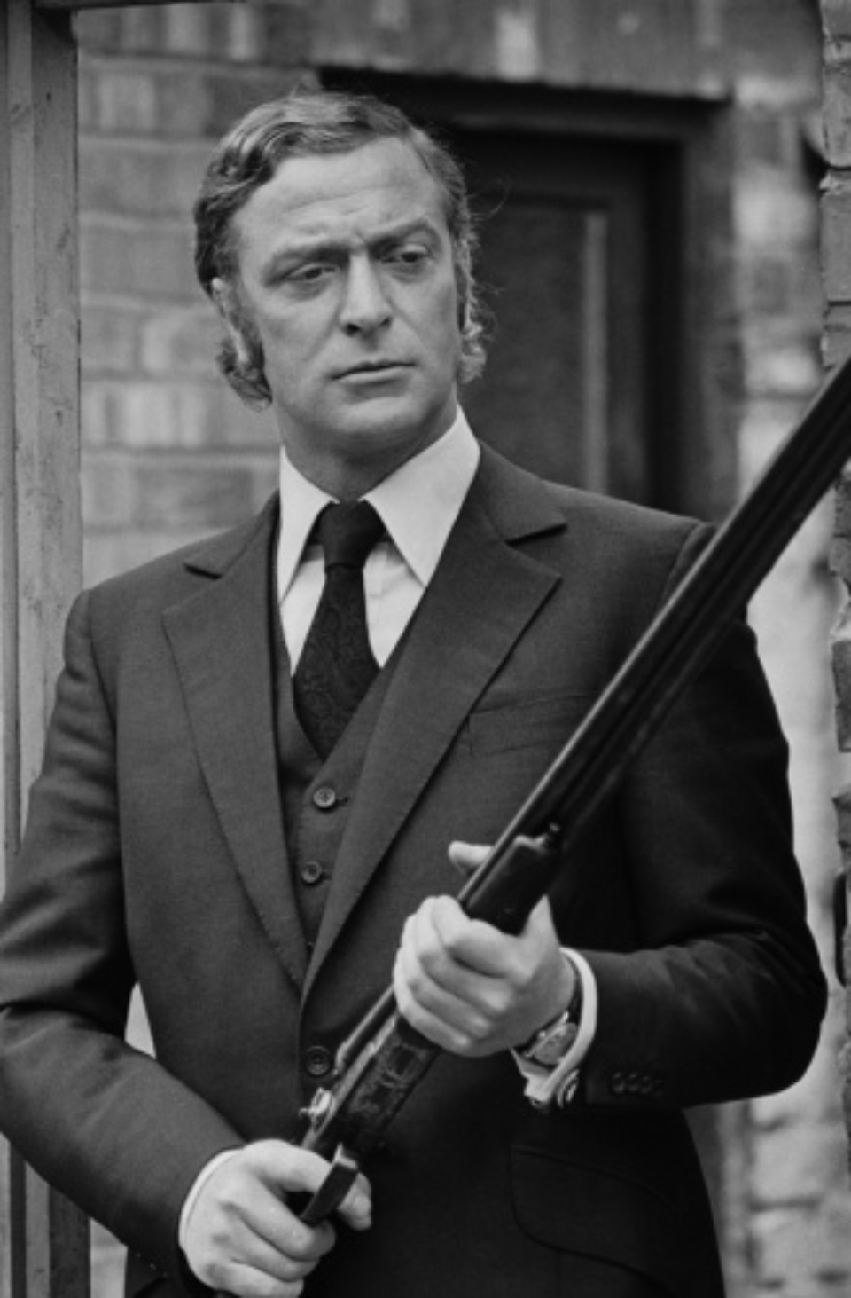 Terry O'Neill: Michael Caine Newcastle, 1971 Gelatin silver print, printed later Signed on recto Signed and numbered on verso 60 x 50 cm Editioned
