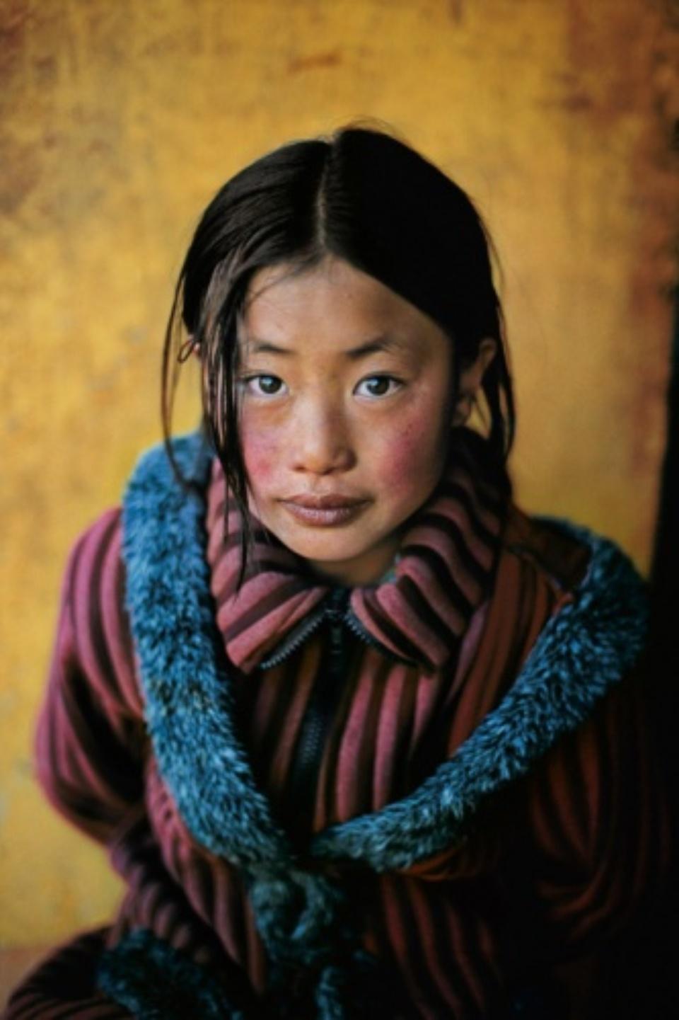 Steve McCurry: Tibetan Girl with New Coat Tibet, 2001 C-Print 50 x 60 cm // 76 x 101 cm // 101 x 152 cm Editioned
