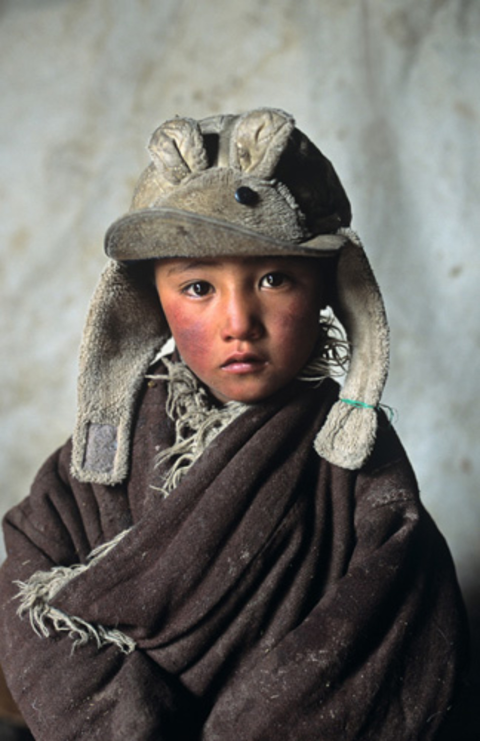 Steve McCurry: Bunny Ears Amdo, Tibet, 2001 Signed, titled, dated and numbered on verso C-print 60 x 50 cm // 101 x 76 cm // 152 x 101 cm Editioned