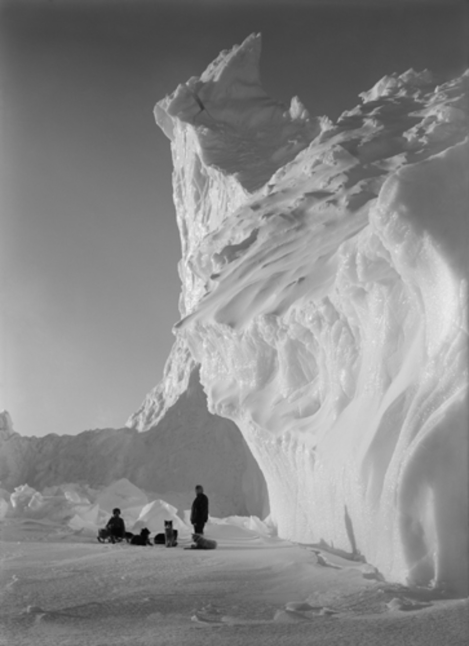 Herbert G. Ponting: Under the Lee of the Castle Berg Antarctica, 17.09.1911 Embossed on recto, numbered on verso Platinum print