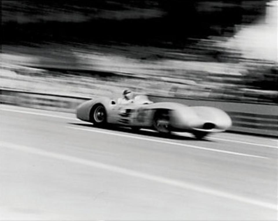 Joseph McKeown: Juan Miguel Fangio Reims, 1954 Silver Gelatin Archival Fibre Print 43 x 95 cm