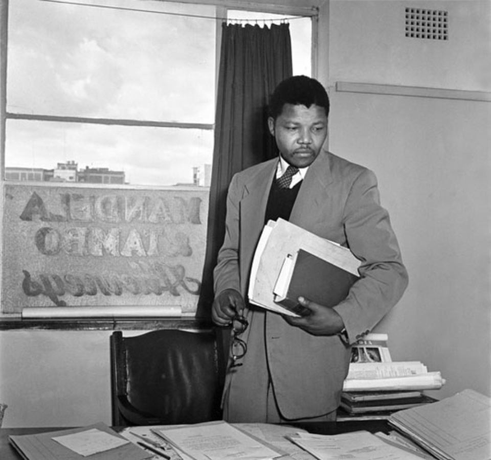 Jürgen Schadeberg Nelson Mandela in his Law Office Johannesburg, 1952 Signed, titled and dated Gelatin silver print, printed later