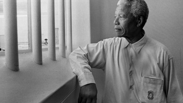 Jürgen Schadeberg Nelson Mandela in his cell (Revisit) Robben Island, 1994 Signed, titled and dated Gelatin silver print, printed later