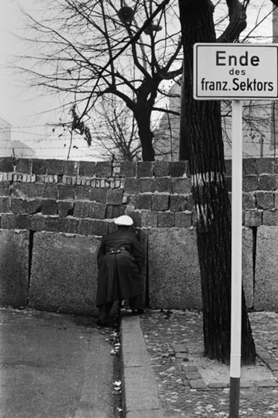 Jürgen Schadeberg Peeping cop Berlin, 1961 Signed and titled Gelatin silver print