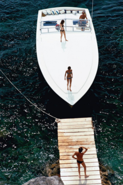 Slim Aarons: Speedboat Landing Italy, 1973
