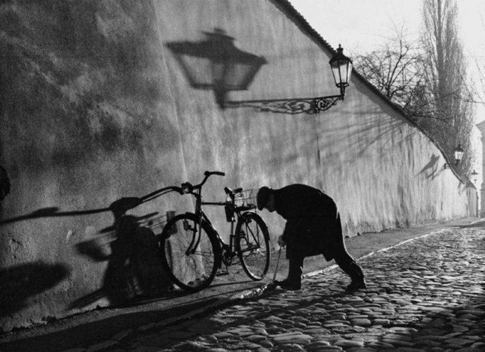 Man preparing Bicycle Prague, 2000