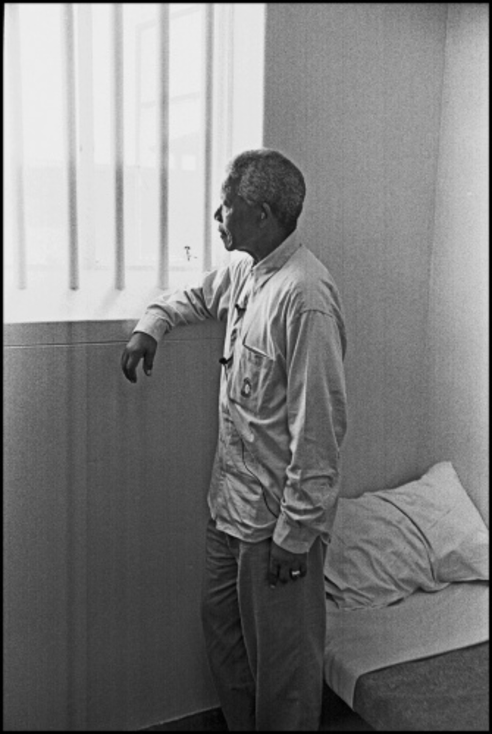 Jürgen Schadeberg Nelson Mandela in his Cell (Revisit), Full Length Robben Island, 1994 Signed, titled and dated Gelatin silver print, printed later