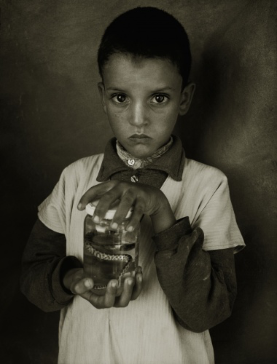 Albert Watson: Mostapha Elhanch, Boy with Jar Marrakech, 1997 Archival pigment print Signed, titled, dated and numbered on verso 76 x 61 cm Ed. 25
