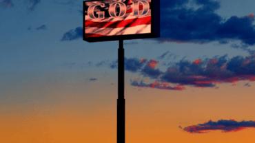 Albert Watson: The GOD sign Route 15, Las Vegas, 2001 Artist label on verso Archival pigment print 76 x 61 cm Ed. 25