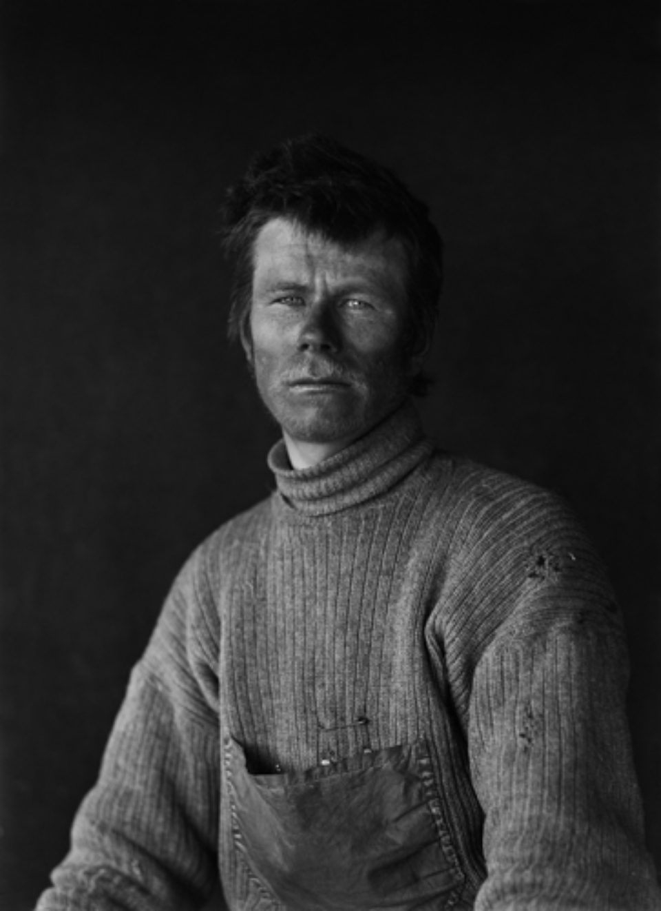 Herbert G. Ponting: Portrait of Dimitri on return from the Barrier January 1912 Embossed on recto, numbered on verso Modern Platinum palladium print Ed.of 30