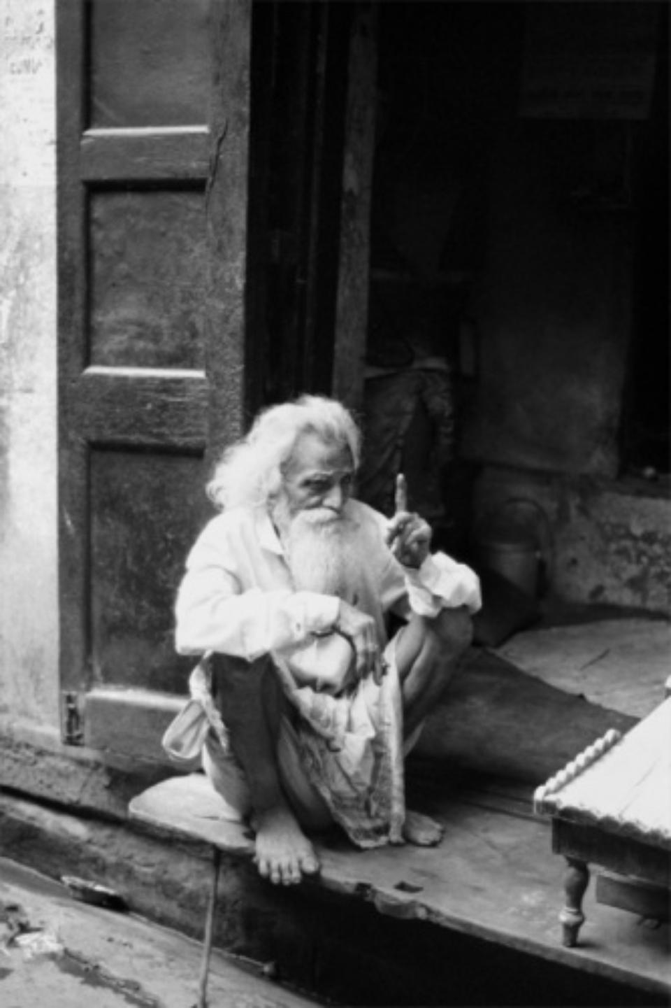 Amy Lyne: man pointing Finger Varansi, 2003 Gelatin silver print