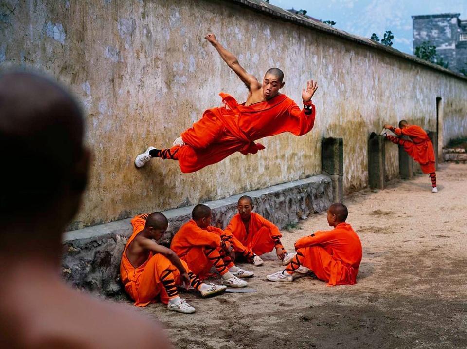 Steve McCurry. Monk Runs on Wall Henan Province, China, 2004
