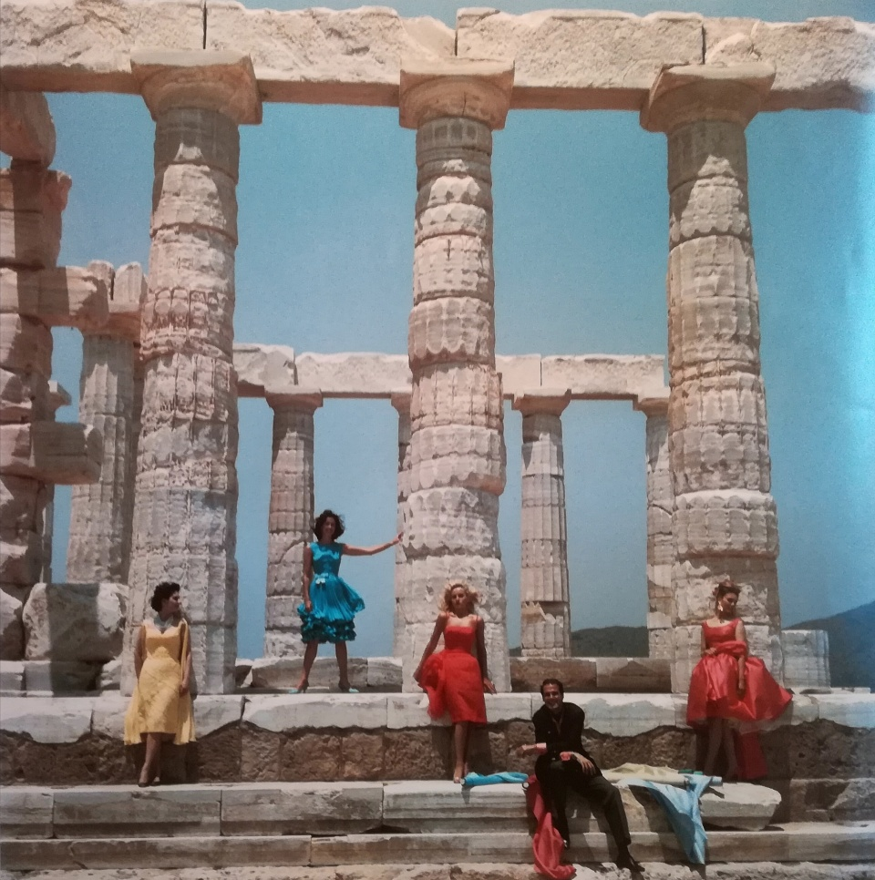 Slim Aarons. Greek fashion designer Dimitris Kristas poses with four models against a backdrop of the ancient Doric temple to POseidon at Sounion, 1967